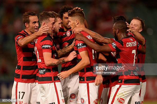 Mark Bridge of the Wanderers celebrates scoring a goal with team mates during the round 12 ALeague match between the Western Sydney Wanderers and...