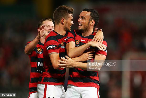 Mark Bridge of the Wanderers celebrates with Dario Vidosic of the Wanderers after scoring the first goal during the round 10 ALeague match between...