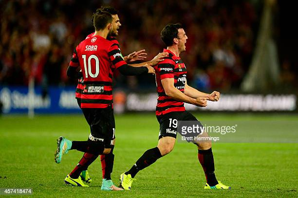 Mark Bridge of the Wanderers celebrates with his team mates after scoring during the round two ALeague match between Sydney FC and the Western Sydney...