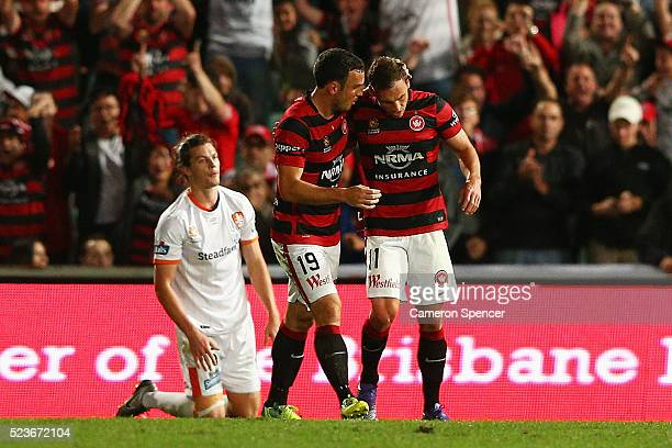 Mark Bridge of the Wanderers congratulates team mate Brendon Santalab of the Wanderers after scoring a goal during the ALeague Semi Final match...