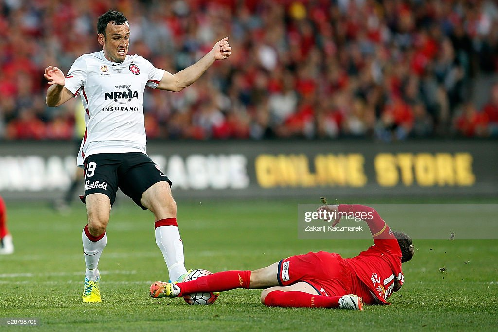 <a gi-track='captionPersonalityLinkClicked' href=/galleries/search?phrase=Mark+Bridge&family=editorial&specificpeople=1630520 ng-click='$event.stopPropagation()'>Mark Bridge</a> of the Wanderers is challenged by Marcelo Carrusca of United during the 2015/16 A-League Grand Final match between Adelaide United and the Western Sydney Wanderers at Adelaide Oval on May 1, 2016 in Adelaide, Australia.