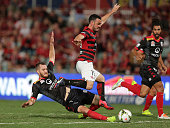 Mark Bridge of the Wanderers is fouled in the area by Nigel Boogard of United during the round 26 ALeague match between the Western Sydney Wanderers...