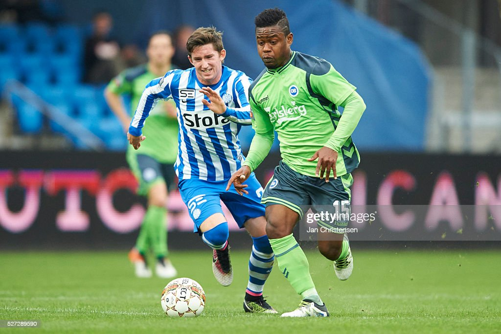 Mark Brink of Esbjerg fB and Izunna Uzochukwu of OB Odense compete for the ball during the Danish Alka Superliga match between Esbjerg fB and OB Odense at Blue Water Arena on May 02, 2016 in Esbjerg, Denmark.