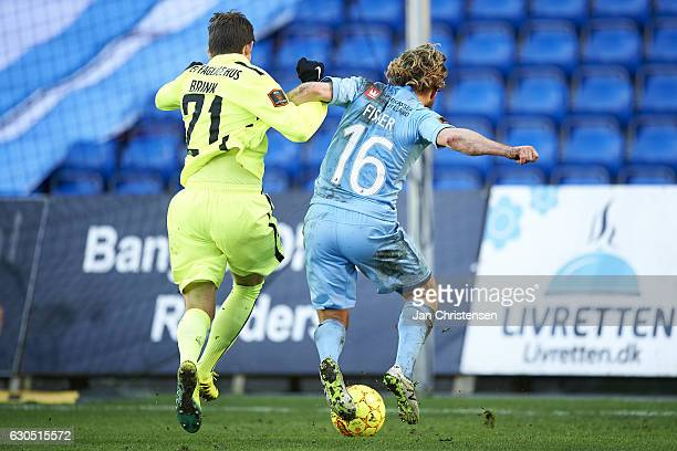 Mark Brink of Esbjerg fB and Kasper Fisker of Randers FC compete for the ball during the Danish Alka Superliga match between Randers FC and Esbjerg...