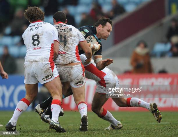 Mark Bryant of London Broncos is stopped by Josh Perry Anthony Laffranchi and James Roby of St Helens during the Stobart Super League match between...