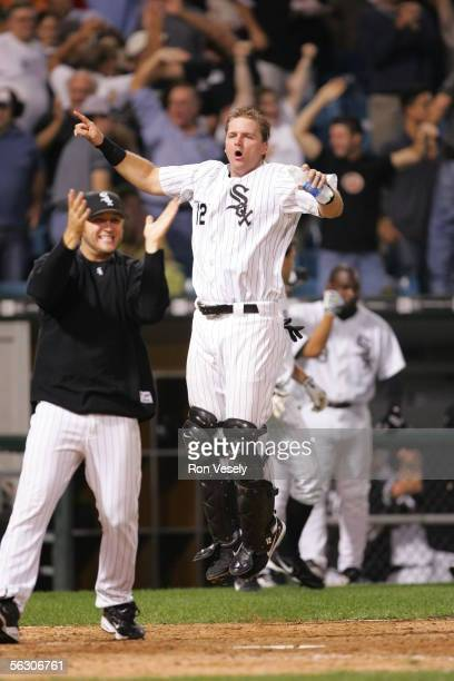 Mark Buehrle and AJ Pierzynski of the Chicago White Sox celebrate a walkoff win against the Cleveland Indians at US Cellular Field on September 20...