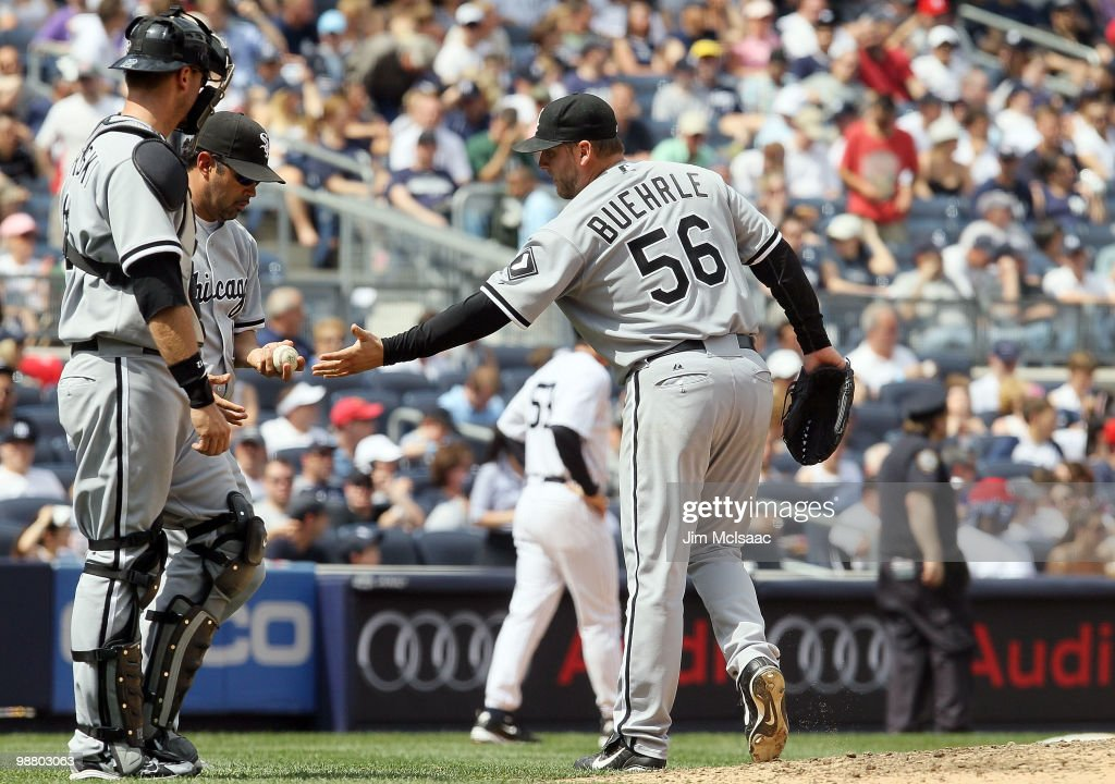 <a gi-track='captionPersonalityLinkClicked' href=/galleries/search?phrase=Mark+Buehrle&family=editorial&specificpeople=204644 ng-click='$event.stopPropagation()'>Mark Buehrle</a> #56 of the Chicago White Sox gives the ball to manager <a gi-track='captionPersonalityLinkClicked' href=/galleries/search?phrase=Ozzie+Guillen&family=editorial&specificpeople=210514 ng-click='$event.stopPropagation()'>Ozzie Guillen</a> as he is removed from the game against the New York Yankees in the fifth inning on May 2, 2010 at Yankee Stadium in the Bronx borough of New York City. The Yankees defeated the White Sox 12-3.