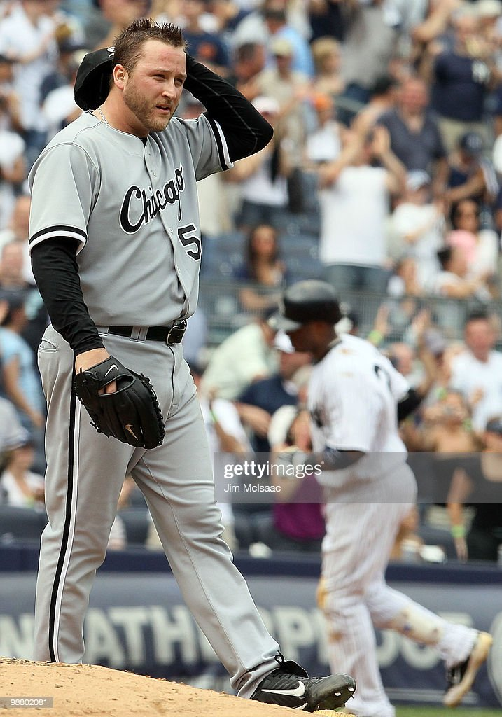 <a gi-track='captionPersonalityLinkClicked' href=/galleries/search?phrase=Mark+Buehrle&family=editorial&specificpeople=204644 ng-click='$event.stopPropagation()'>Mark Buehrle</a> #56 of the Chicago White Sox looks on after surrendering a fifth inning three run home run to <a gi-track='captionPersonalityLinkClicked' href=/galleries/search?phrase=Robinson+Cano&family=editorial&specificpeople=538362 ng-click='$event.stopPropagation()'>Robinson Cano</a> #24 of the New York Yankees on May 2, 2010 at Yankee Stadium in the Bronx borough of New York City. The Yankees defeated the White Sox 12-3.