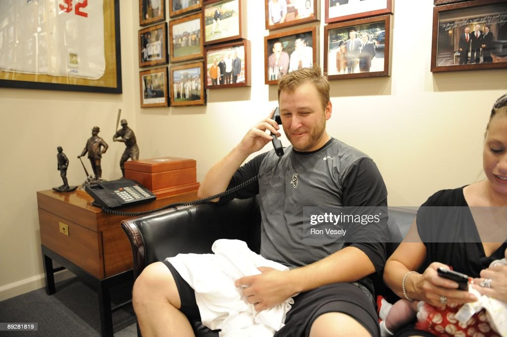 Mark Buehrle #56 of the Chicago White Sox talks to President Barack Obama after recording the 18th perfect game in major league history against the Tampa Bay Rays on July 23, 2009 at U.S. Cellular Field in Chicago, Illinois. The White Sox defeated the Rays 5-0.