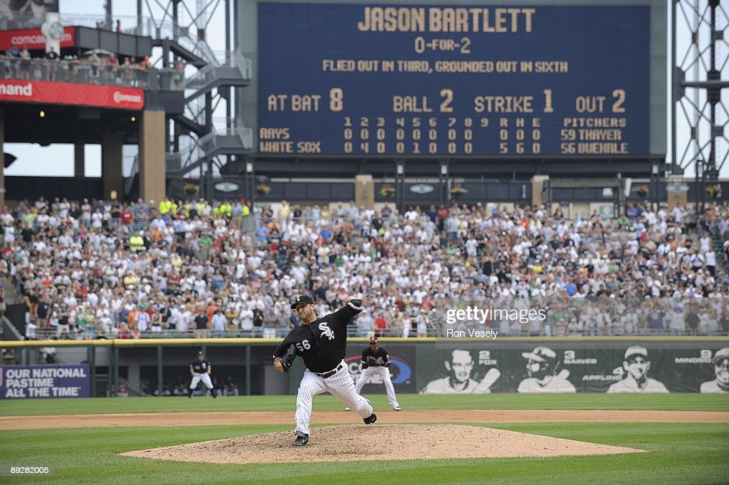 Mark Buehrle #56 of the Chicago White Sox throws the final pitch of the game to Jason Bartlett to record the 18th perfect game in major league history against the Tampa Bay Rays on July 23, 2009 at U.S. Cellular Field in Chicago, Illinois. The White Sox defeated the 5-0.
