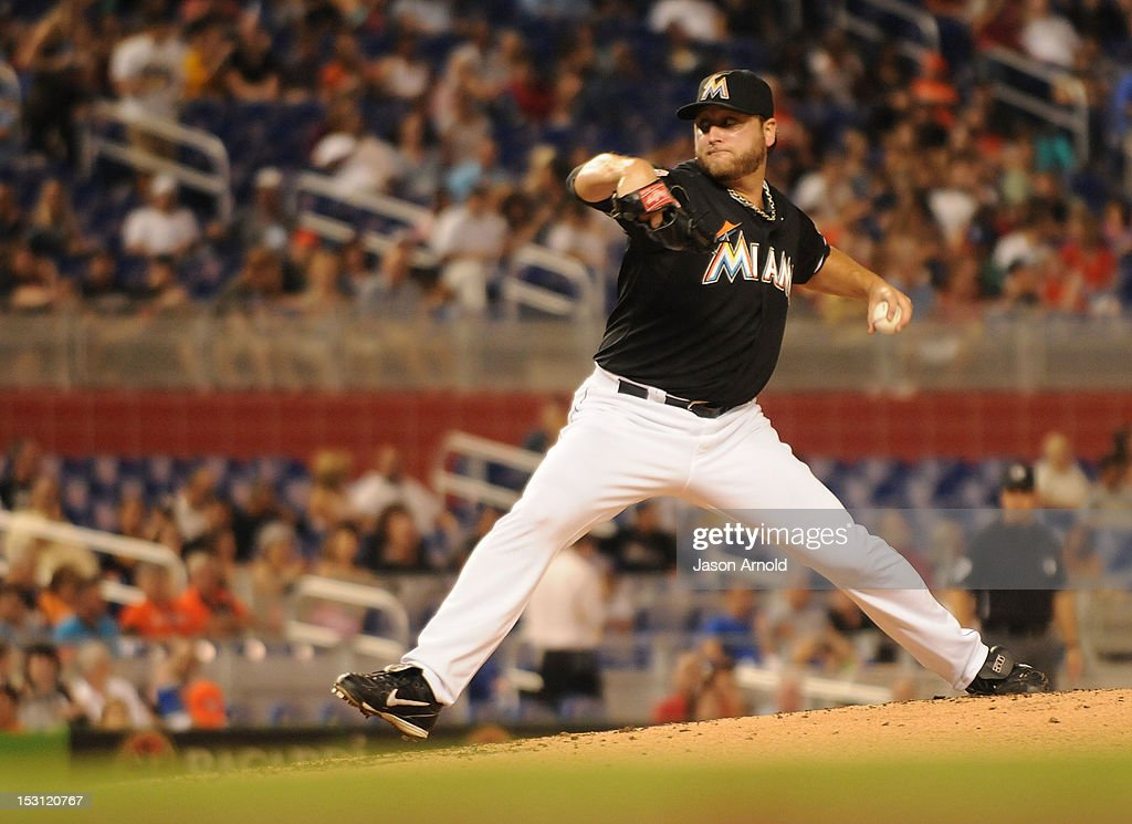 <a gi-track='captionPersonalityLinkClicked' href=/galleries/search?phrase=Mark+Buehrle&family=editorial&specificpeople=204644 ng-click='$event.stopPropagation()'>Mark Buehrle</a> #56 of the Miami Marlins pitches against the Philadelphia Phillies at Marlins Park on September 28, 2012 in Miami, Florida.