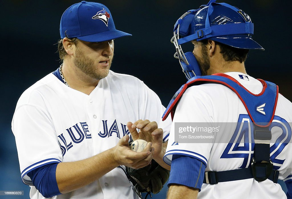 <a gi-track='captionPersonalityLinkClicked' href=/galleries/search?phrase=Mark+Buehrle&family=editorial&specificpeople=204644 ng-click='$event.stopPropagation()'>Mark Buehrle</a> of the Toronto Blue Jays gets a visit to the mound from <a gi-track='captionPersonalityLinkClicked' href=/galleries/search?phrase=J.P.+Arencibia&family=editorial&specificpeople=4959430 ng-click='$event.stopPropagation()'>J.P. Arencibia</a> during MLB game action against the Chicago White Sox on April 15, 2013 at Rogers Centre in Toronto, Ontario, Canada. All uniformed team members are wearing jersey number 42 in honor of Jackie Robinson Day.