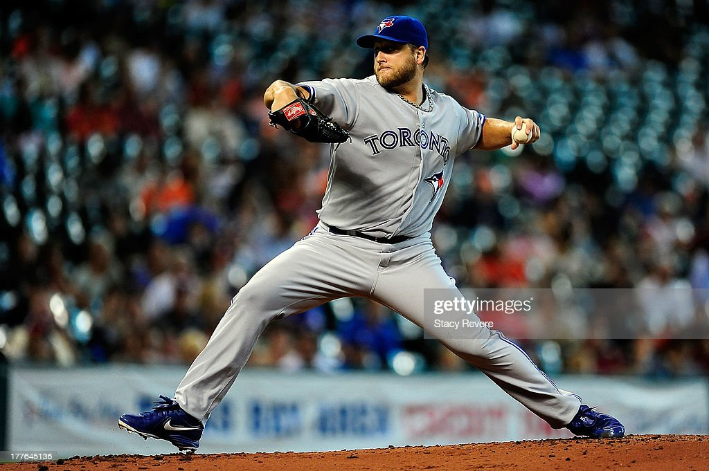 Mark Buehrle #56 of the Toronto Blue Jays throws a pitch in the third inning against the Houston Astros during a game at Minute Maid Park on August 25, 2013 in Houston, Texas.
