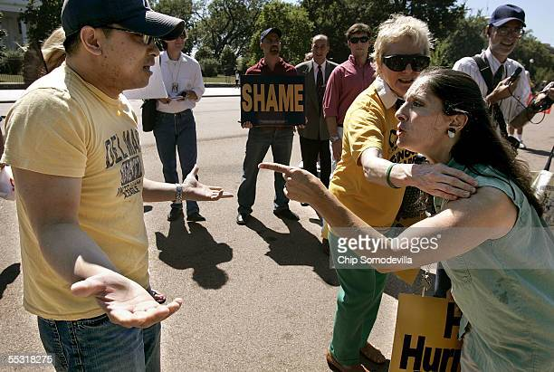 Mark Bui and Donna Saady argue in front of the White House while MoveOn PAC members and supporters marched in protest of the Bush Administration's...