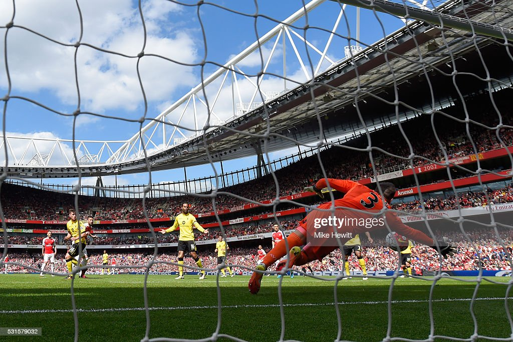 Mark Bunn of Aston Villa dives in vain as Olivier Giroud (3rd L) of Arsenal scores his team's first goal during the Barclays Premier League match between Arsenal and Aston Villa at Emirates Stadium on May 15, 2016 in London, England.