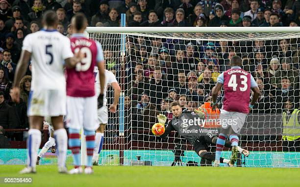 Mark Bunn of Aston Villa saves a penalty during the Barclays Premier League match between Aston Villa and Leicester City at Villa Park on January 16...