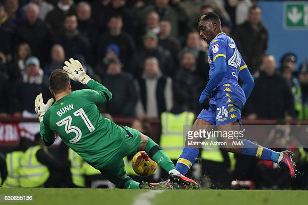 Mark Bunn of Aston Villa saves from Hadi Sacko of Leeds United during the Sky Bet Championship match between Aston Villa and Leeds United at Villa...