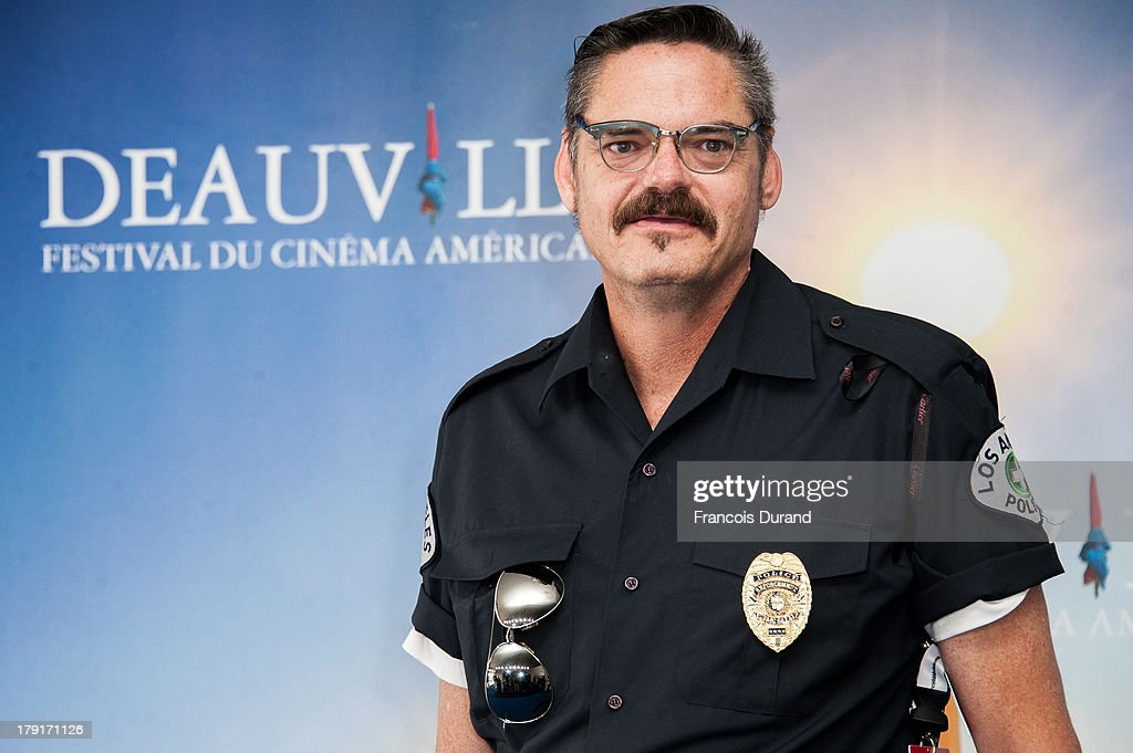Mark Burnham poses at a photocall for the film 'Wrong Cops' during the 39th Deauville American film festival on September 1, 2013 in Deauville, France.