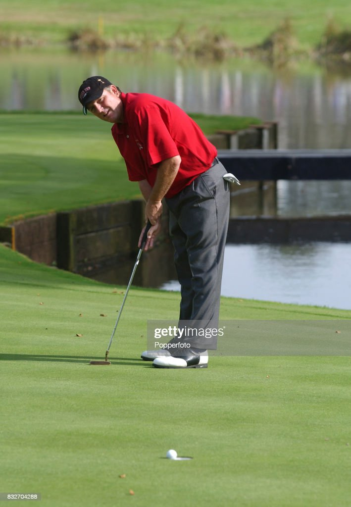 Mark Calcavecchia of Team USA putting on the 10th green during his singles match against Padraig Harrington of Team Europe during the Ryder Cup at...