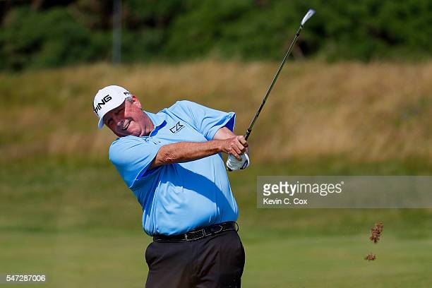 Mark Calcavecchia of the United States plays a shot on the 12th hole during the first round on day one of the 145th Open Championship at Royal Troon...