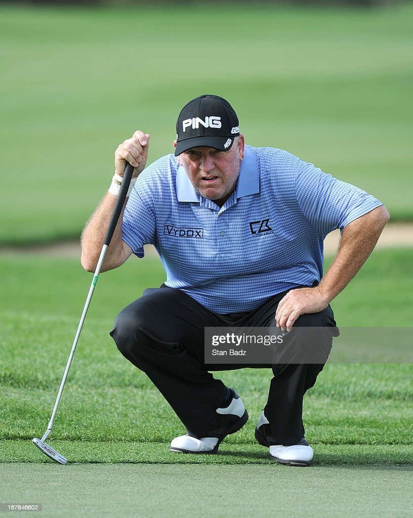 Mark Calcavecchia studies his putt on the first hole during the final round of the Legends Division at the Liberty Mutual Insurance Legends of Golf...