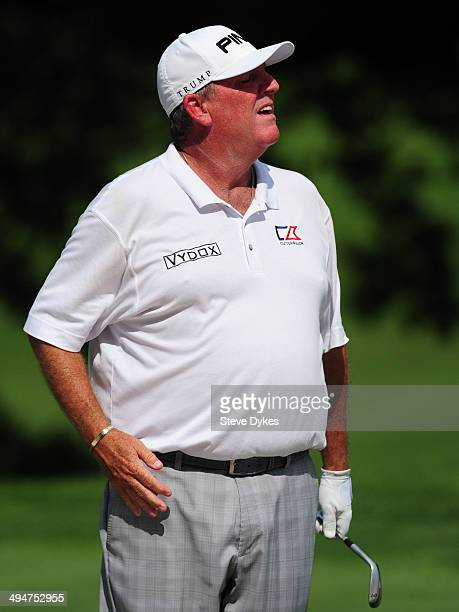 Mark Calcavecchia takes a look over a ridge on the 18th hole during the first round of the Principal Charity Classic the Wakonda Club on May 30 2014...