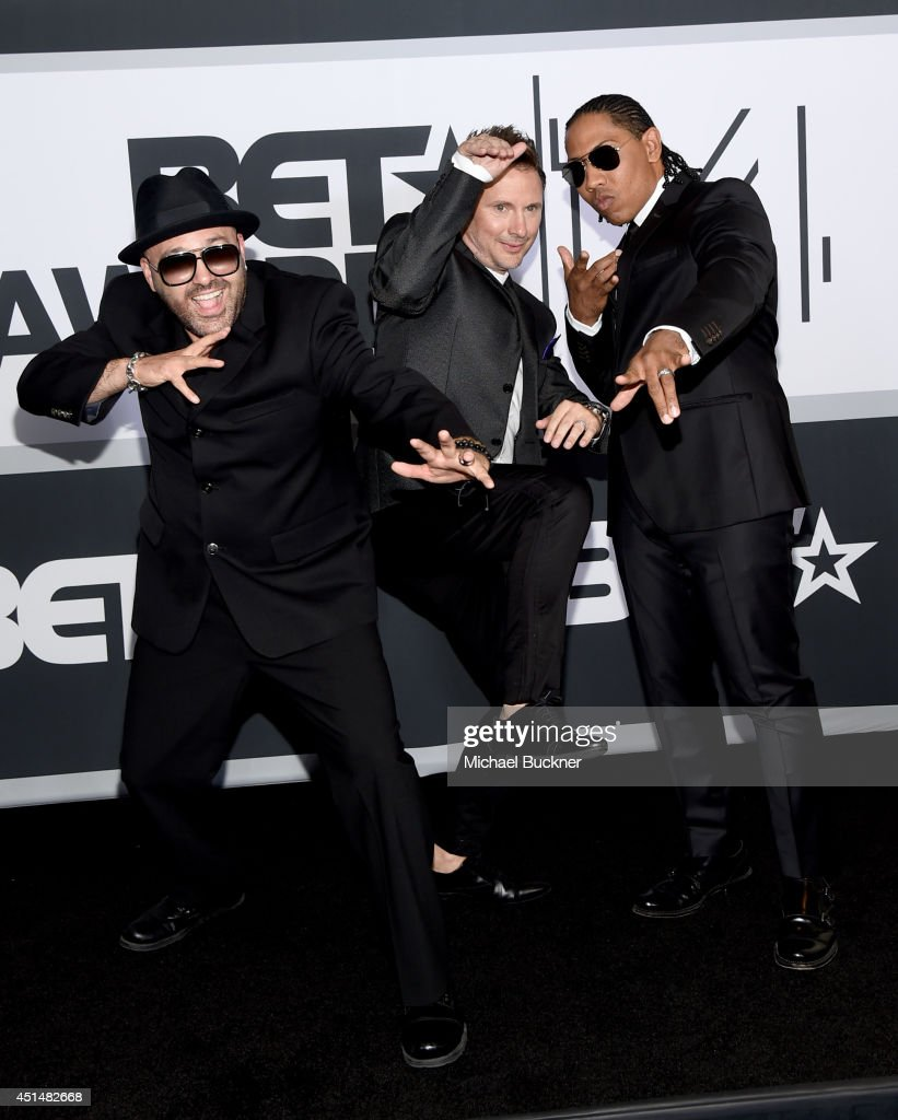 Mark Calderon Martin Kember and Kevin 'KT' Thornton of Color Me Badd pose in the press room during the BET AWARDS '14 at Nokia Theatre LA LIVE on...