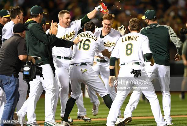 Mark Canha of the Oakland Athletics and teammates celebrates Canha hitting a walk off solo home run to defeat the Boston Red Sox 32 in the bottom of...