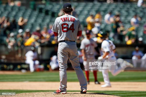 Mark Canha of the Oakland Athletics rounds the bases after hitting a home run off of Ben Taylor of the Boston Red Sox during the fifth inning at the...