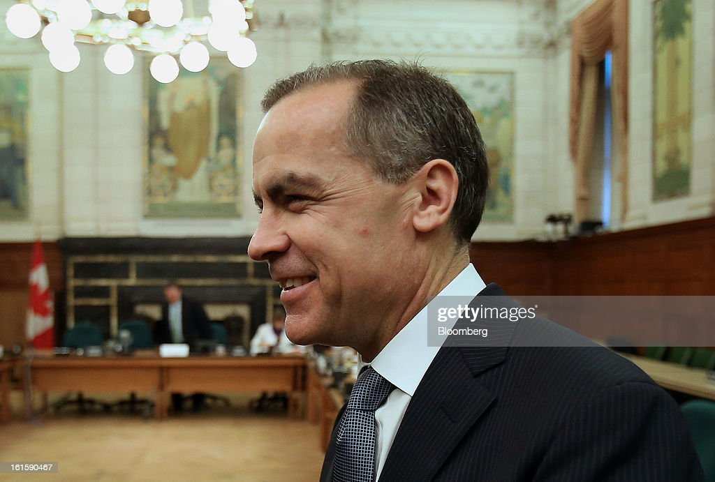 Mark Carney, governor of the Bank of Canada, arrives to testify before the House of Commons finance committee in Ottawa, Ontario, Canada, on Tuesday, Feb. 12, 2013. Carney reiterated the need for raising his 1 percent policy interest rate is less imminent. Photographer: Patrick Doyle/Bloomberg via Getty Images