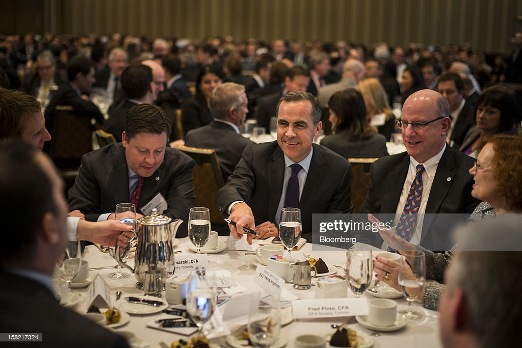<a gi-track='captionPersonalityLinkClicked' href=/galleries/search?phrase=Mark+Carney&family=editorial&specificpeople=3028157 ng-click='$event.stopPropagation()'>Mark Carney</a>, governor of the Bank of Canada, center, attends a CFA Society Toronto luncheon in Toronto, Ontario, Canada, on Tuesday, Dec. 11, 2012. Carney said central bank guidance on the path of interest rates may be more useful in circumstances such as major slumps or financial imbalances. Photographer: Ian Willms/Bloomberg via Getty Images