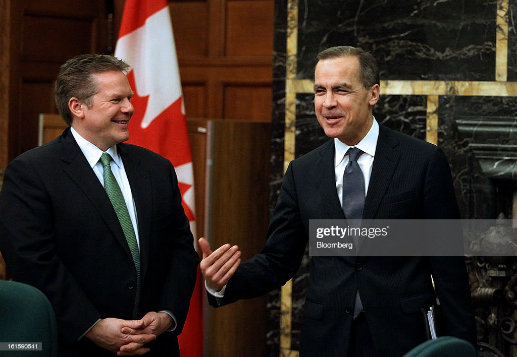 <a gi-track='captionPersonalityLinkClicked' href=/galleries/search?phrase=Mark+Carney&family=editorial&specificpeople=3028157 ng-click='$event.stopPropagation()'>Mark Carney</a>, governor of the Bank of Canada, right, speaks with Commons Finance Committee Chairman James Rajotte while arriving to testify in Ottawa, Ontario, Canada, on Tuesday, Feb. 12, 2013. Carney reiterated the need for raising his 1 percent policy interest rate is less imminent. Photographer: Patrick Doyle/Bloomberg via Getty Images