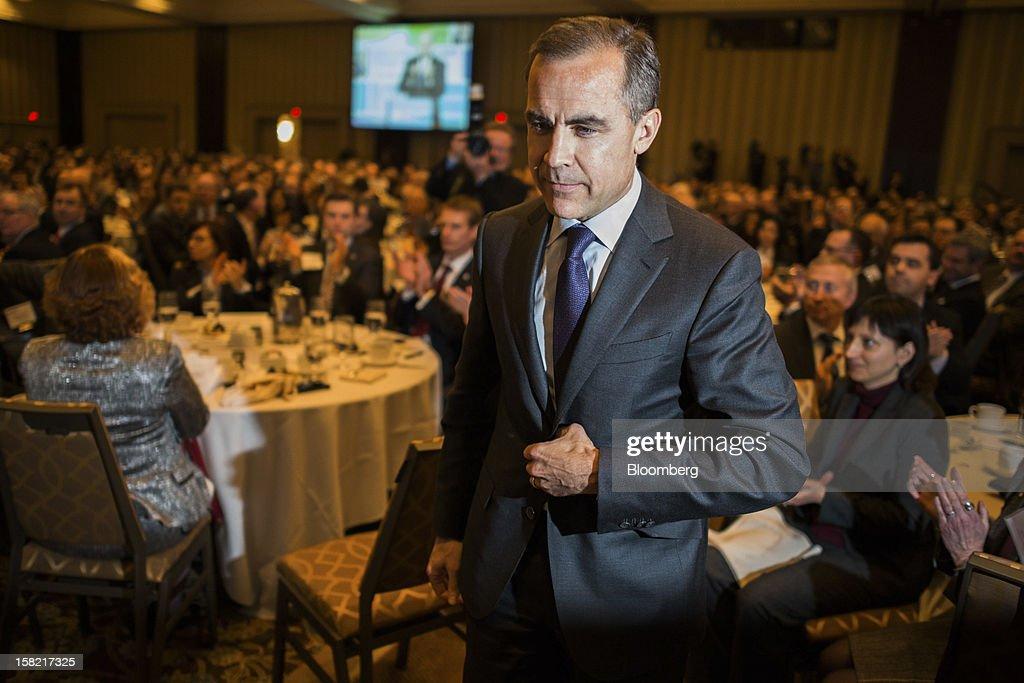 <a gi-track='captionPersonalityLinkClicked' href=/galleries/search?phrase=Mark+Carney&family=editorial&specificpeople=3028157 ng-click='$event.stopPropagation()'>Mark Carney</a>, governor of the Bank of Canada, walks to the podium to speak to the CFA Society Toronto in Toronto, Ontario, Canada, on Tuesday, Dec. 11, 2012. Carney said central bank guidance on the path of interest rates may be more useful in circumstances such as major slumps or financial imbalances. Photographer: Ian Willms/Bloomberg via Getty Images