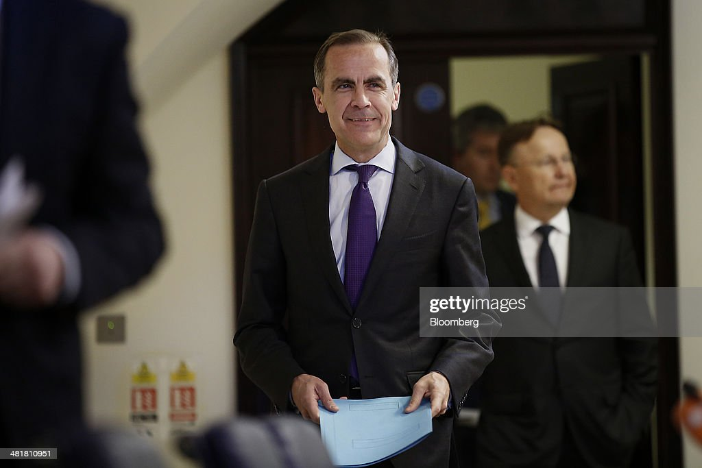 <a gi-track='captionPersonalityLinkClicked' href=/galleries/search?phrase=Mark+Carney&family=editorial&specificpeople=3028157 ng-click='$event.stopPropagation()'>Mark Carney</a>, governor of the Bank of England and chairman of the Financial Stability Board (FSB), reacts as he enters a news conference after the board's plenary meeting at the Bank of England in London, U.K., on Monday, March 31, 2014. Moving toward a common set of bank resolution rules is one of the key issues when the Financial Stability Board meets in London today, as the club of central bankers and regulators seeks to complete its mission of avoiding a repeat of the turmoil that followed the 2008 collapse of Lehman Brothers Holdings Inc. Photographer: Simon Dawson/Bloomberg via Getty Images