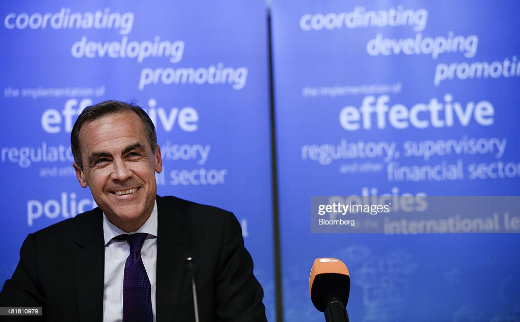 <a gi-track='captionPersonalityLinkClicked' href=/galleries/search?phrase=Mark+Carney&family=editorial&specificpeople=3028157 ng-click='$event.stopPropagation()'>Mark Carney</a>, governor of the Bank of England and chairman of the Financial Stability Board (FSB), reacts during a news conference after the board's plenary meeting at the Bank of England in London, U.K., on Monday, March 31, 2014. Moving toward a common set of bank resolution rules is one of the key issues when the Financial Stability Board meets in London today, as the club of central bankers and regulators seeks to complete its mission of avoiding a repeat of the turmoil that followed the 2008 collapse of Lehman Brothers Holdings Inc. Photographer: Simon Dawson/Bloomberg via Getty Images