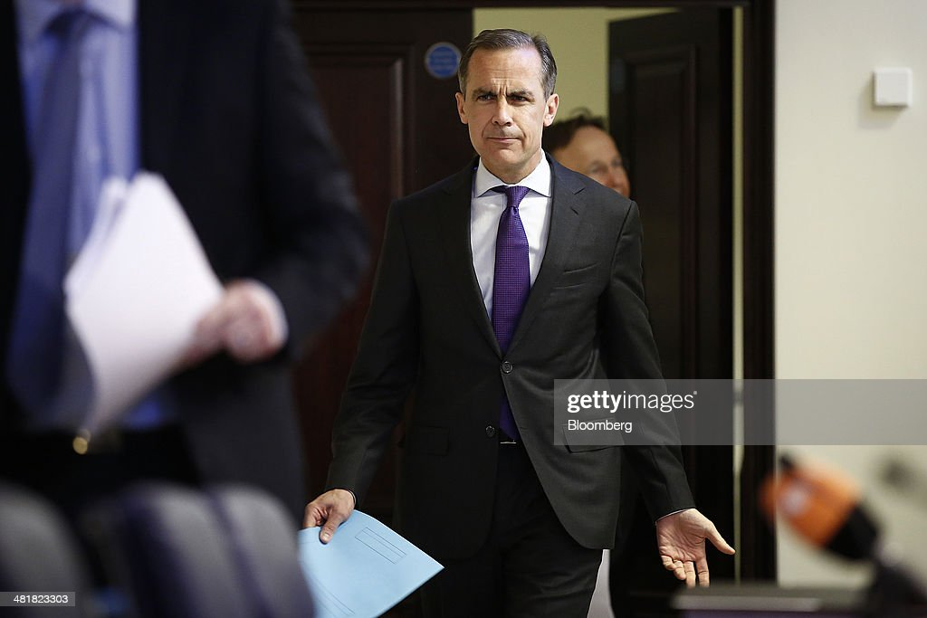 Mark Carney, governor of the Bank of England and chairman of the Financial Stability Board (FSB), reacts as he arrives to attend a news conference following the board's plenary meeting at the Bank of England in London, U.K., on Monday, March 31, 2014. Carney said the FSB wants lenders and the International Swaps and Derivatives Association Inc., an industry group, to come up with proposals to write temporary pauses into derivatives contracts struck with banks that hit financial trouble. Photographer: Simon Dawson/Bloomberg via Getty Images