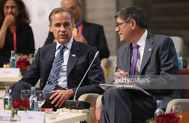 Mark Carney Governor of the Bank of England and Jacob Lew US Secretary of the Treasury arrive for a symposium during a meeting of finance ministers...
