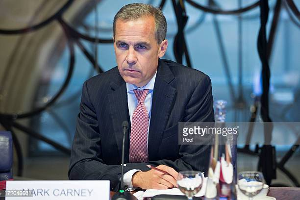 Mark Carney governor of the Bank Of England attends a monetary policy committee briefing on his first day inside the central bank's headquarters on...
