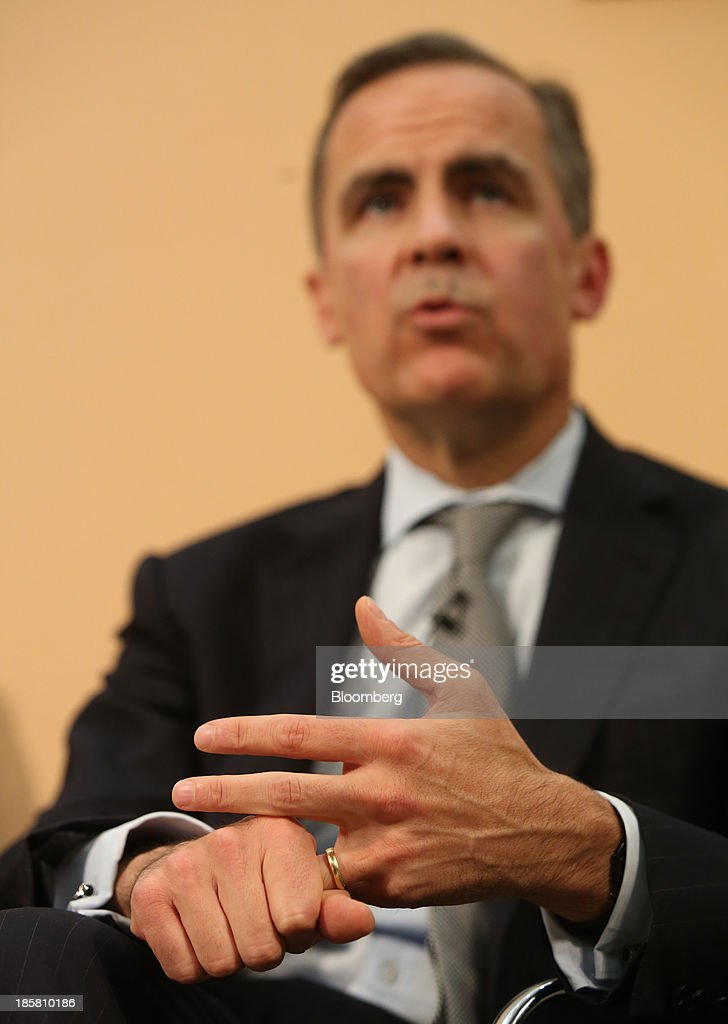 Mark Carney, governor of the Bank of England, grips his hands as he speaks during an event to mark the 125th anniversary of the Financial Times in London, U.K., on Thursday, Oct. 24, 2013. U.K. economic growth accelerated to its fastest pace in more than three years in the third quarter as the recovery continued across all main industries. Photographer: Chris Ratcliffe/Bloomberg via Getty Images
