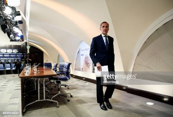 Mark Carney governor of the Bank of England leaves following the bank's quarterly inflation report news conference in London UK on Wednesday Aug 13...
