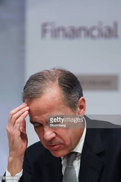 Mark Carney governor of the Bank of England reacts during the bank's financial stability report news conference at the Bank of England in the City of...