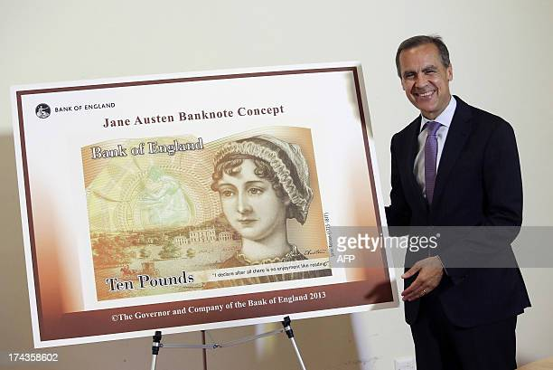 Mark Carney governor of the Bank of England stands alongside the concept design for the new Bank of England ten pound banknote featuring author Jane...