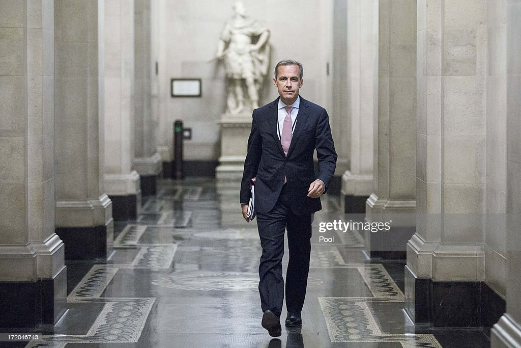 <a gi-track='captionPersonalityLinkClicked' href=/galleries/search?phrase=Mark+Carney&family=editorial&specificpeople=3028157 ng-click='$event.stopPropagation()'>Mark Carney</a>, governor of the Bank Of England, walks to a monetary policy committee (MPC) briefing on his first day inside the central bank's headquarters on July 1, 2013 in London, England. Carney takes the Bank Of England helm today, facing a struggle to make his policies count more than those of his US counterpart for UK government debt.