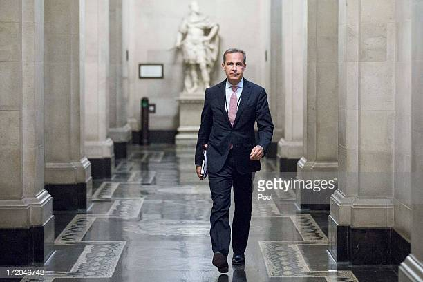 Mark Carney governor of the Bank Of England walks to a monetary policy committee briefing on his first day inside the central bank's headquarters on...