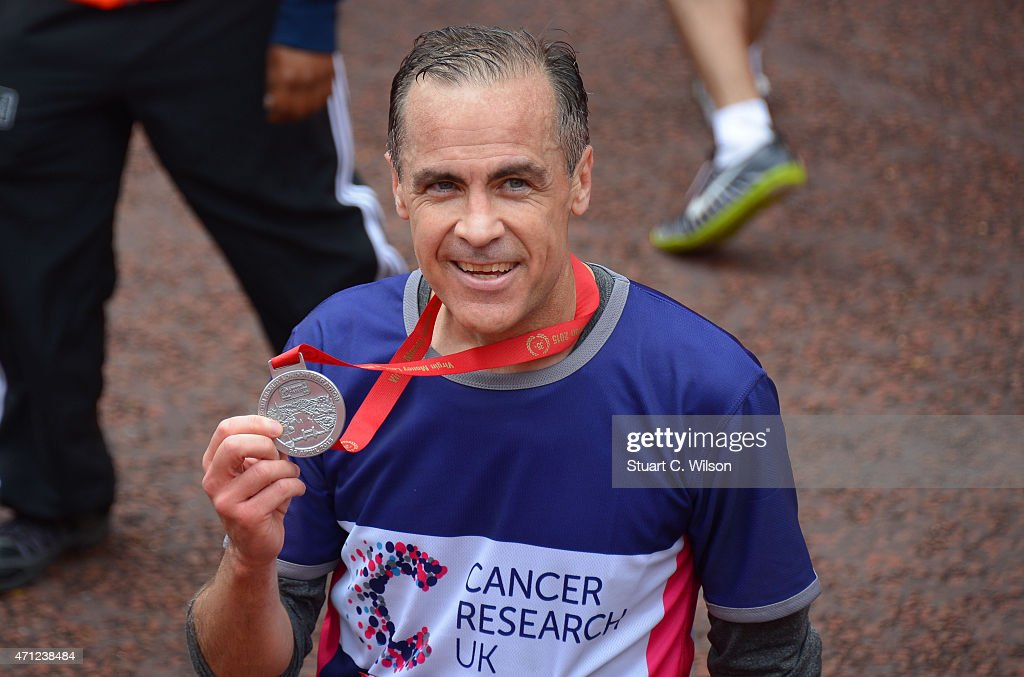 Mark Carney poses at the finish line during The London Marathon 2015 on April 26, 2015 in London, England.