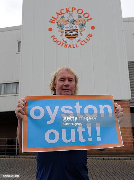Mark Cartmell a lifelong Blackpool FC fan holds a poster protesting against club chairman Karl Oyston during the Pre Season Friendly match between...