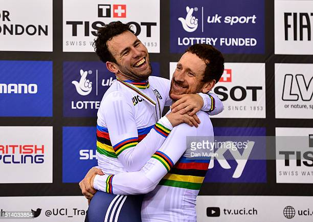 Mark Cavendish and Sir Bradley Wiggins of Great Britain celebrate on the medal podium after winning The Men's Madison Final during Day Five of the...