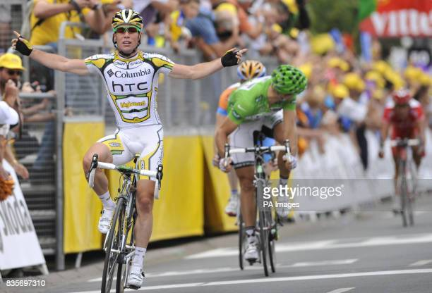 Mark Cavendish crosses over the finish line to win the 10th Stage of the Tour De France in Limoges France