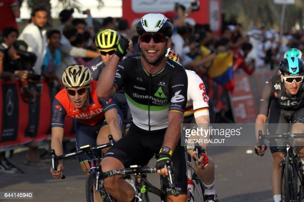 Mark Cavendish from Dimension Data cycling team celebrates as he crosses the finish line in Madinat Zayed to win the opening stage of the 2017 Abu...