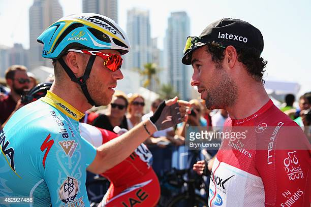 Mark Cavendish of Great Britain and Etixx QuickStep chats to Lars Boom of The Netherlands and the Astana Pro Team at the start of stage four of the...